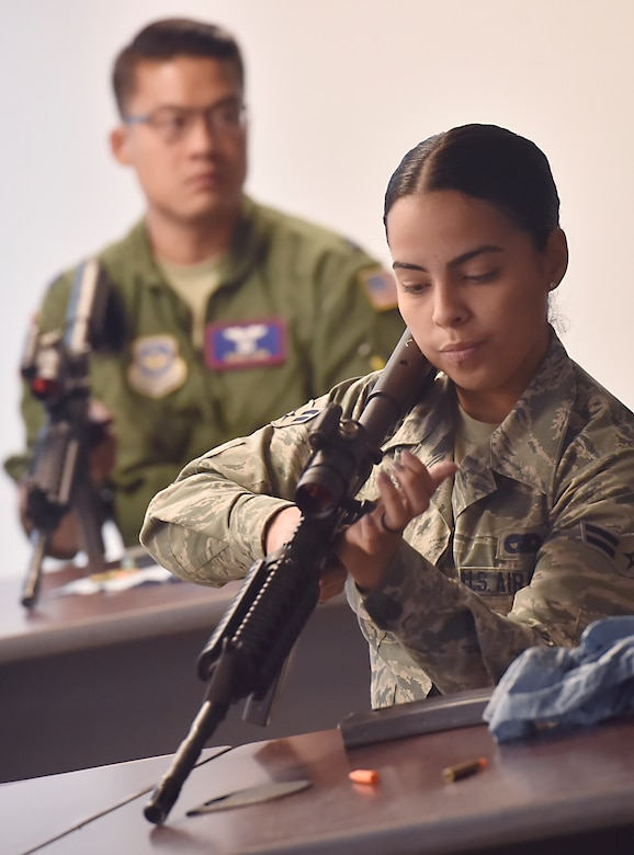 Airman 1st Class Jeanette Medina Vega, 437th Aerial Port Squadron passenger travel technician, learns the fundamentals of an M-4 rifle from Senior Airman Dylan Ricketts, 628th Security Forces Squadron Combat Arms Training and Maintenance instructor, during a classroom session June 5, 2018, at Joint Base Charleston, S.C. CATM instructors at Joint Base Charleston support all military branches and are responsible for qualifying service members and civilians on various weapons