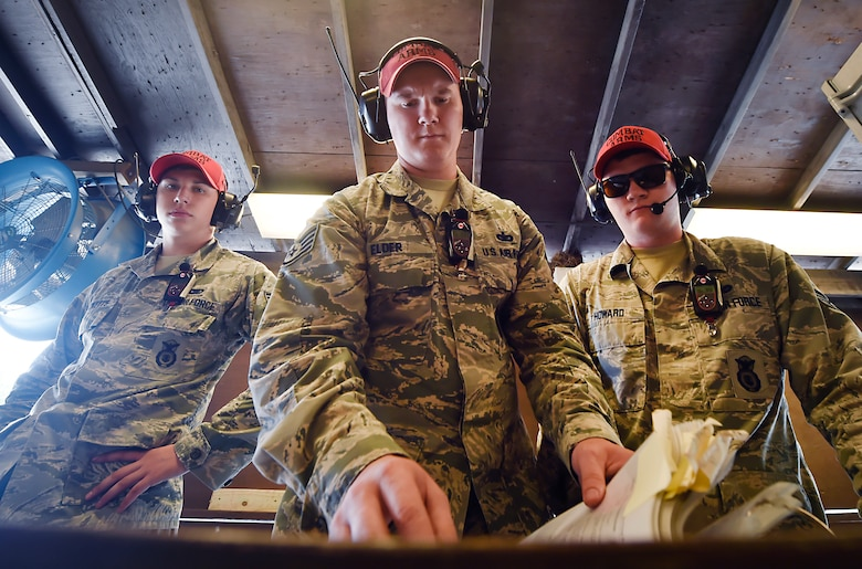 From left to right, Senior Airman Dylan Ricketts, Staff Sgt. Alexander Elder and Staff Sgt. Howard, all 628th Security Forces Squadron Combat Arms Training and Maintenance instructors, prepare to instruct an M-4 rifle qualifying course June 5, 2018, at Joint Base Charleston, S.C. CATM instructors at Joint Base Charleston support all military branches and are responsible for qualifying service members and civilians on various weapons.