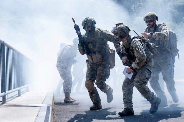 Joint terminal attack controllers from the Slovenian Armed Forces conduct urban warfare training exercises during Adriatic Strike 2018, Celje, Slovenia, June 4, 2018. The Colorado Air National Guard, 140th Wing, Buckley Air Force Base, Coloo. brought four F-16 Fighting Falcons and approximately 40 support personnel to participate in Adriatic Strike 2018, a Slovenian-led JTAC training attended by 22 other NATO nations to conduct interoperability training and joint readiness capabilities among the NATO allies and partners. (U.S. Air National Guard photo by Staff Sgt. Michelle Y. Alvarez-Rea)