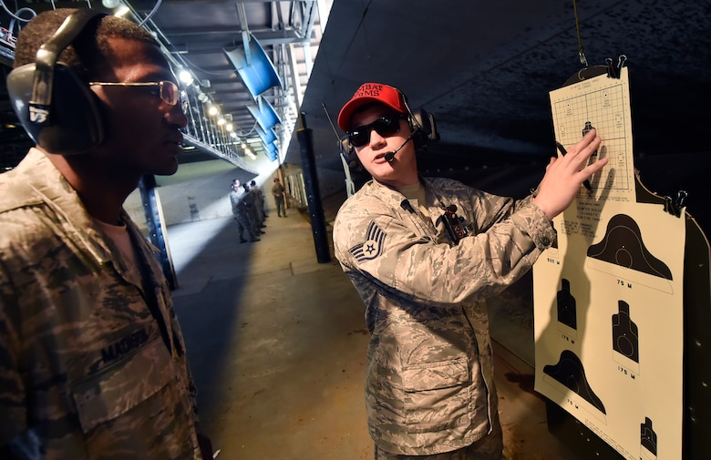 Staff Sgt. Brandon Howard, 628th Security Forces Squadron Combat Arms Training and Maintenance instructor, trains an M-4 rifle course student during a qualifying course June 5, 2018, at Joint Base Charleston, S.C. CATM instructors at Joint Base Charleston support all military branches and are responsible for qualifying service members and civilians on various weapons.