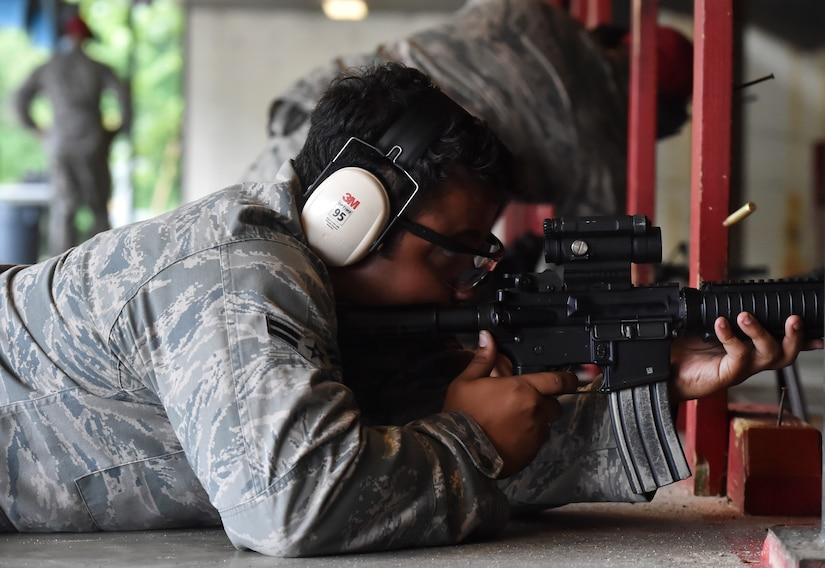 Airman 1st Class Isaiah Wynn, 628th Logistics Readiness Squadron, fires an M-4 rifle during a qualifying course facilitated by 628th Security Forces Squadron Combat Arms Training and Maintenance instructors June 5, 2018, at Joint Base Charleston, S.C. CATM instructors at Joint Base Charleston support all military branches and are responsible for qualifying service members and civilians on various weapons.