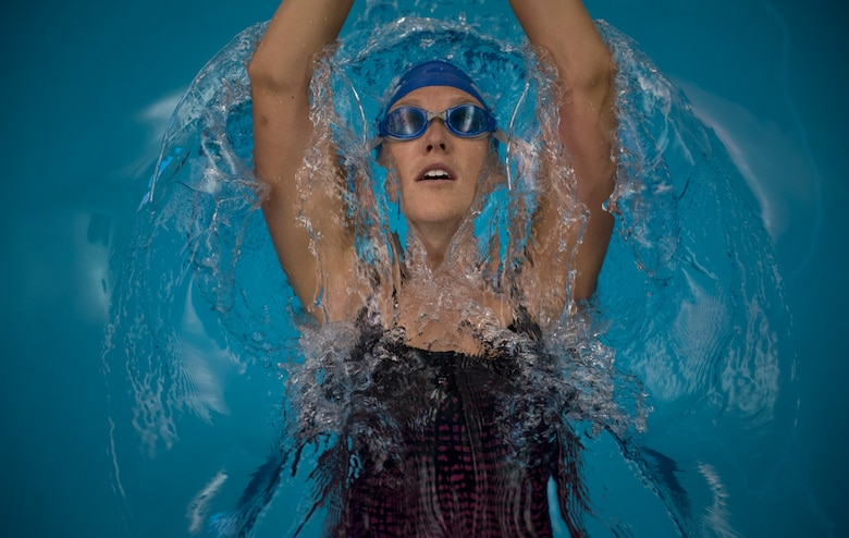 Kristen Morris, Department of Defense Warrior Games athlete on Team Air Force, practices her backstroke during a swimming training session in Colorado Springs, Colo., June 5, 2018. Morris will compete against athletes from the other U.S. military services, as well as athletes representing the United Kingdom, Australia and Canada. (U.S. Air Force photo by Senior Airman Dennis Hoffman)