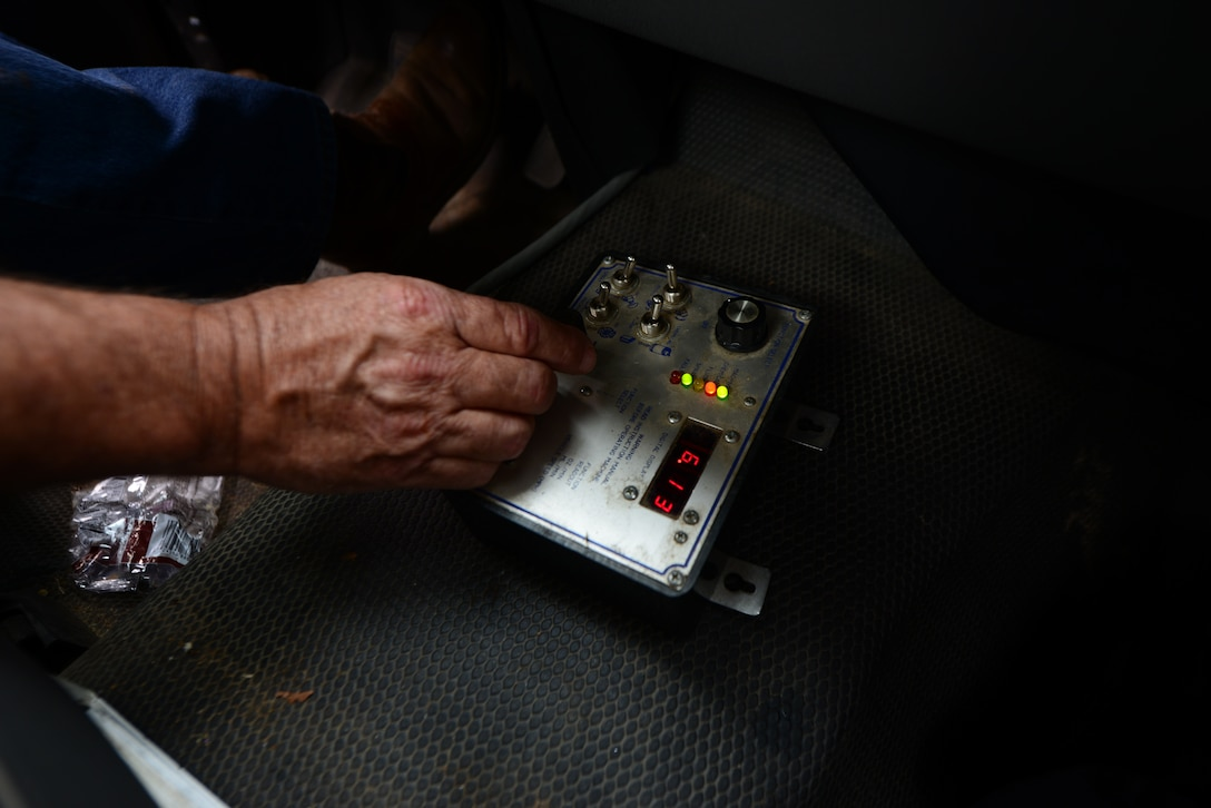 Robert Miller, 14th Civil Engineer Squadron pest controller, controls the output of pesticides from a control panel inside his team utility vehicle June 5, 2018, on Columbus Air Force Base, Mississippi. The control panel not only controls the pesticide output, it also controls the fan speed and direction of the fog. (U.S. Air Force photo by Airman 1st Class Beaux Hebert)