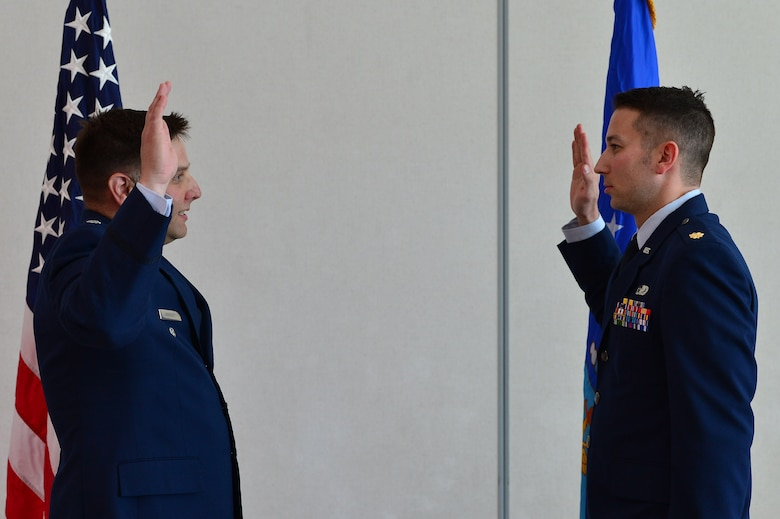 Maj. Phillip, 732nd Operations Group chief of intelligence, recites his oath of office during his promotion ceremony March 31, 2018, in Las Vegas. Though he is a third generation Airman, Phillip is the first generation officer in his family. (U.S. Air Force photo by Airman 1st Class Haley Stevens)