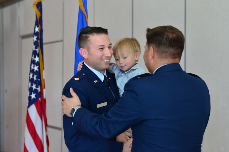 Maj. Phillip, 732nd Operations Group chief of intelligence, thanks Lt. Col. Daniel Finkelstein, presiding officer of Maj. Phillip's promotion ceremony March 31, 2018, in Las Vegas. Phillip expressed his family's excitement for their continued growth and the opportunity to lead future Airmen. (U.S. Air Force photo by Airman 1st Class Haley Stevens)