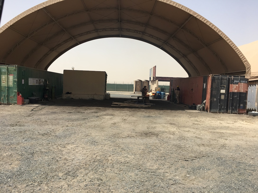 Visitors from DLA Installation Operations observe daily operations like demilitarization to help determine if the agency employees have the enough space and the proper facilities to support their work.