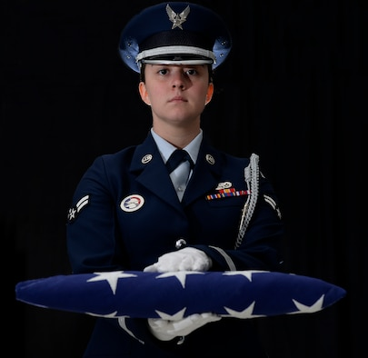 Airman 1st Class Julia C. Schultz, assigned to the 157th Force Support Squadron, poses for a portait on June 7, 2018 at Pease Air National Guard Base, N.H. Schultz has participated in more than 105 veteran funerals throughout New England since joining the Pease Base Honor Guard more than a year ago. (N.H. National Guard photo illlustration by Staff Sgt. Kayla White)
