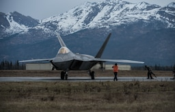 An F-22 Raptor refuels at Joint Base Elmendorf-Richardson, Alaska, May 10, 2018. The F-22's combination of stealth, supercruise, maneuverability, and integrated avionics, coupled with improved supportability, represents an exponential leap in warfighting capabilities. The Raptor performs both air-to-air and air-to-ground missions allowing full realization of operational concepts vital to the 21st century Air Force.