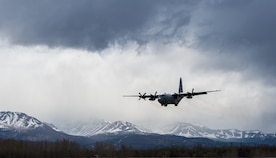 A C-130 Hercules approaches the flightline for landing at Joint Base Elmendorf-Richardson, Alaska, May 10, 2018. The C-130 can accommodate a wide variety of oversized cargo, including utility helicopters and six-wheeled armored vehicles to standard palletized cargo and passengers. In an aerial delivery role, it can airdrop loads up to 42,000 pounds or use its high-flotation landing gear to land and deliver cargo on rough, dirt strips.