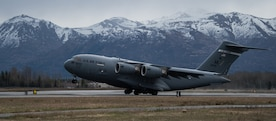 An Alaska Air National Guard C-17 Globemaster III assigned to the 176th Wing takes off from Joint Base Elmendorf-Richardson, Alaska, May 10, 2018. The C-17 Globemaster III is the newest, most flexible cargo aircraft to enter the airlift force. It's capable of rapid strategic delivery of troops and all types of cargo to main operating bases or directly to forward bases in the deployment area.