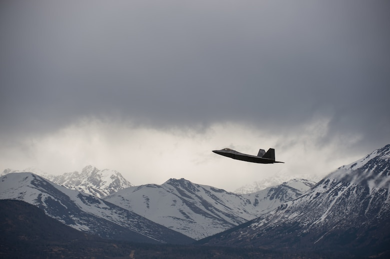 An F-22 Raptor soars over the Chugach Mountains near Joint Base Elmendorf-Richardson, Alaska, May 10, 2018. The F-22's combination of stealth, supercruise, maneuverability, and integrated avionics, coupled with improved supportability, represents an exponential leap in warfighting capabilities. The Raptor performs both air-to-air and air-to-ground missions allowing full realization of operational concepts vital to the 21st century Air Force.