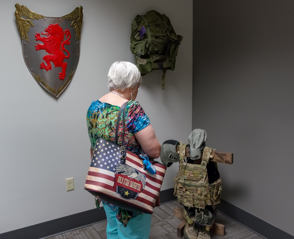 Diane Moore, Gold Star Family Member, admires a fallen Airman memorial at Cody Hall during the 81st Training Group Honorary Commanders' tour on Keesler Air Force Base, Mississippi, June 7, 2018. The event also included tours at the 338th Training Squadron and the 81st Training Support Squadron Trainer Development Center. (U.S. Air Force photo by Andre Askew)