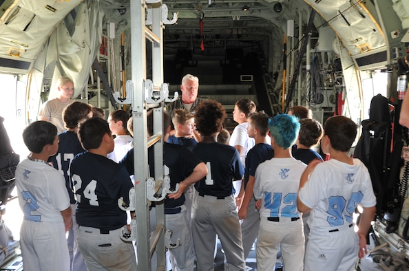 Lt. Col. Shane Devlin, 53rd Weather Reconnaissance pilot instructor, gives the Crescent City Hooks youth baseball team a tour of a WC-130J at Keesler Air Force Base, Miss. today. (U.S. Air Force photo by Master Sgt. Jessica Kendziorek)