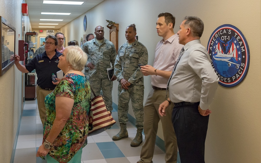 Local community leaders admire World War II memorabilia at Cody Hall during an 81st Training Group Honorary Commanders' tour on Keesler Air Force Base, Mississippi, June 7, 2018. The purpose of the tour is to better educate the honorary commanders on the 81st TRG mission and capabilities. (U.S. Air Force photo by Andre Askew)
