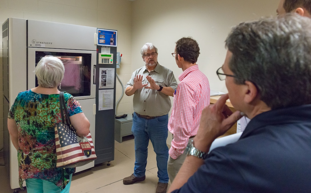 James Hall, 81st Training Support Squadron chief production contractor, briefs local community leaders on the capabilities of the 3D printer at the Trainer Development Center during an 81st Training Group Honorary Commanders' tour at Keesler Air Force Base, Mississippi, June 7, 2018. The purpose of the tour is to better educate the honorary commanders on the 81st TRG mission and capabilities. (U.S. Air Force photo by Andre Askew)