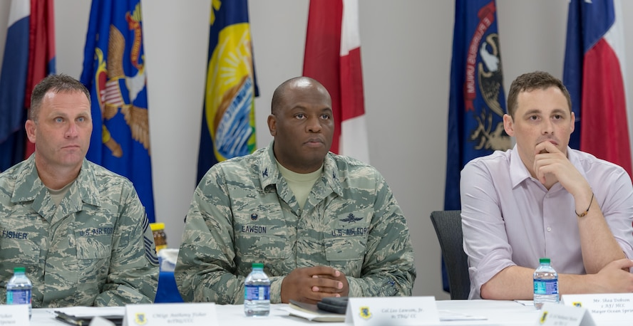 U.S. Air Force Chief Master Sgt. Anthony Fisher, 81st Training Group superintendent, Col. Leo Lawson Jr., 81st TRG commander, and Shea Dobson, Ocean Springs Mayor, attend the 81st TRG mission briefing during an 81st TRG Honorary Commanders' tour at the Levitow Training Support Facility on Keesler Air Force Base, Mississippi, June 7, 2018. The tour also included briefings at the 334th Training Squadron air traffic control tower simulator and the 81st Training Support Squadron Trainer Development Center. (U.S. Air Force photo by Andre Askew)