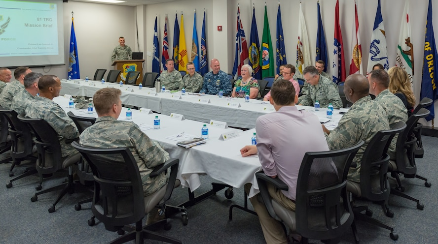 Local community leaders attend the 81st Training Group mission briefing during an 81st TRG Honorary Commanders' tour at the Levitow Training Support Facility on Keesler Air Force Base, Mississippi, June 7, 2018. The tour also included briefings at the 334th Training Squadron air traffic control tower simulator and the 81st Training Support Squadron Trainer Development Center. (U.S. Air Force photo by Andre Askew)