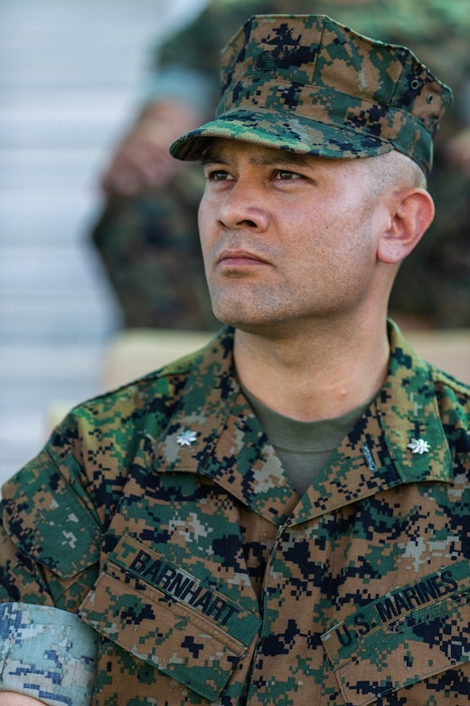 Lt. Col. Robert M. Barnhart, on-coming commanding officer, 1st Battalion, 7th Marine Regiment, listens to a speech given by his predecessor during the unit's change of command ceremony aboard the Marine Corps Air Ground Combat Center, Twentynine Palms, Calif., June 4, 2018. The change of command ceremony ensures that the unit and its Marines are never without official leadership, and also signifies an allegiance of Marines to their unit's commander. (U.S. Marine Corps photo by Lance Cpl. Rachel K. Porter)