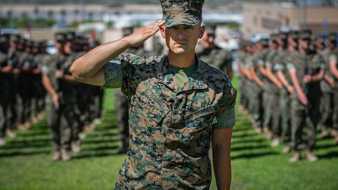 Capt. Colin Elsasser, assistant operations officer, 1st Battalion, 7th Marine Regiment salutes the colors during the unit's change of command ceremony aboard the Marine Corps Air Ground Combat Center, Twentynine Palms, Calif., June 4, 2018. The change of command ceremony ensures that the unit and its Marines are never without official leadership, and also signifies an allegiance of Marines to their unit's commander. (U.S. Marine Corps photo by Lance Cpl. Rachel K. Porter)