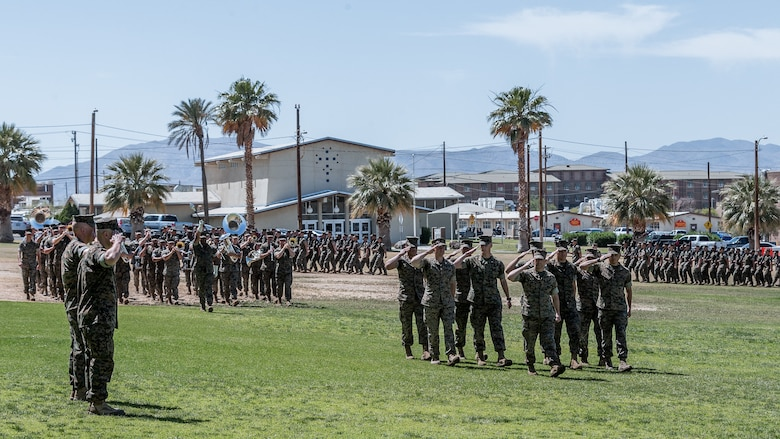A pass in review takes place during the 1st Battalion, 7th Marine Regiment change of command ceremony aboard the Marine Corps Air Ground Combat Center, Twentynine Palms, Calif., June 4, 2018. The change of command ceremony ensures that the unit and its Marines are never without official leadership, and also signifies an allegiance of Marines to their unit's commander. (U.S. Marine Corps photo by Lance Cpl. Rachel K. Porter)