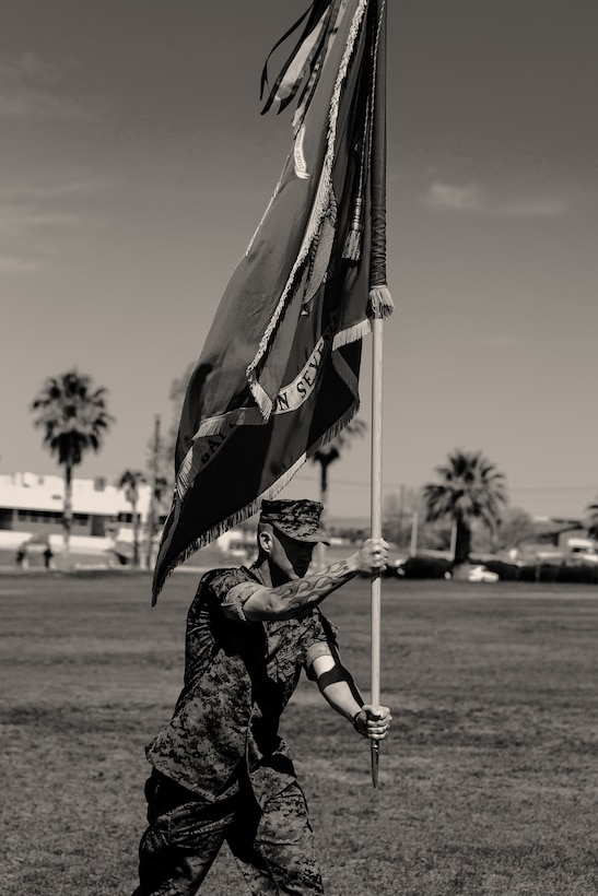 Sgt. Maj. Brian E. Anderson, sergeant major, 1st Battalion, 7th Marine Regiment, carries the battalion colors during the unit's change of command ceremony aboard the Marine Corps Air Ground Combat Center, Twentynine Palms, Calif., June 4, 2018. The change of command ceremony ensures that the unit and its Marines are never without official leadership, and also signifies an allegiance of Marines to their unit's commander. (U.S. Marine Corps photo by Lance Cpl. Rachel K. Porter)