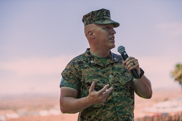 Lt. Col. Erick T. Clark, off-going commanding officer, 1st Battalion, 7th Marine Regiment, gives a speech during the unit's change of command ceremony aboard the Marine Corps Air Ground Combat Center, Twentynine Palms, Calif., June 4, 2018. The change of command ceremony ensures that the unit and its Marines are never without official leadership, and also signifies an allegiance of Marines to their unit's commander. (U.S. Marine Corps photo by Lance Cpl. Rachel K. Porter)