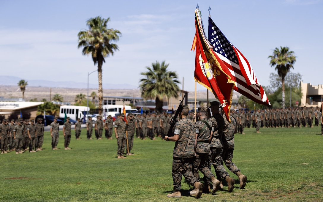 1st Battalion, 7th Marine Regiment's color guard posts during the unit's change of command ceremony aboard the Marine Corps Air Ground Combat Center, Twentynine Palms, Calif., June 4, 2018. The change of command ceremony ensures that the unit and its Marines are never without official leadership, and also signifies an allegiance of Marines to their unit's commander. (U.S. Marine Corps photo by Lance Cpl. Rachel K. Porter)