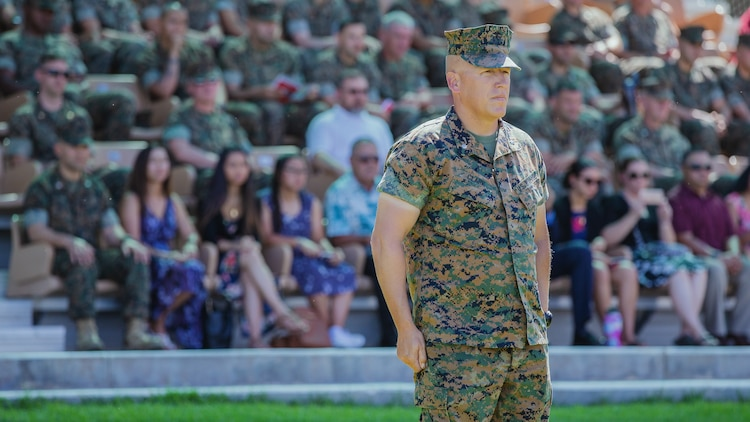 Lt. Col. Erick T. Clark, off-going commanding officer, 1st Battalion, 7th Marine Regiment, stands in the reviewing box during the change of command ceremony of 1st Battalion, 7th Marine Regiment aboard the Marine Corps Air Ground Combat Center, Twentynine Palms, Calif., June 4, 2018. The change of command ceremony ensures that the unit and its Marines are never without official leadership, and also signifies an allegiance of Marines to their unit's commander. (U.S. Marine Corps photo by Lance Cpl. Rachel K. Porter)