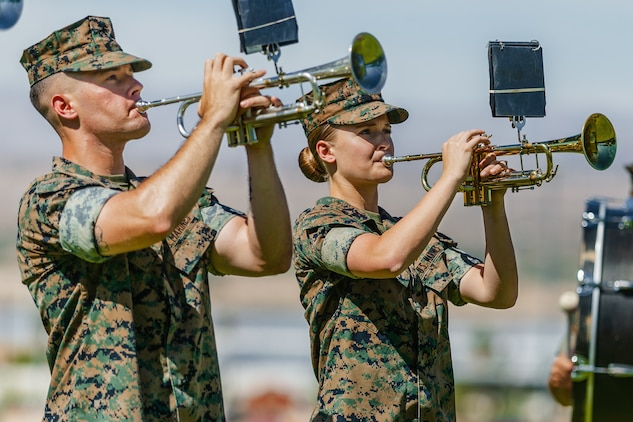 Marines with the 1st Marine Division band perform during 1st Battalion, 7th Marine Regiment's change of command ceremony aboard the Marine Corps Air Ground Combat Center, Twentynine Palms, Calif., June 4, 2018. The change of command ceremony ensures that the unit and its Marines are never without official leadership, and also signifies an allegiance of Marines to their unit's commander. (U.S. Marine Corps photo by Lance Cpl. Rachel K. Porter)