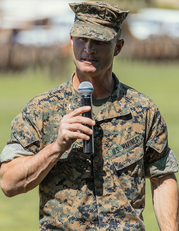 Col. Kyle B. Ellison, commanding officer, 7th Marine Regiment, gives a speech commemorating the new commanding officer of 1st Battalion, 7th Marine Regiment aboard the Marine Corps Air Ground Combat Center, Twentynine Palms, Calif., June 4, 2018. The change of command ceremony ensures that the unit and its Marines are never without official leadership, and also signifies an allegiance of Marines to their unit's commander. (U.S. Marine Corps photo by Lance Cpl. Rachel K. Porter)