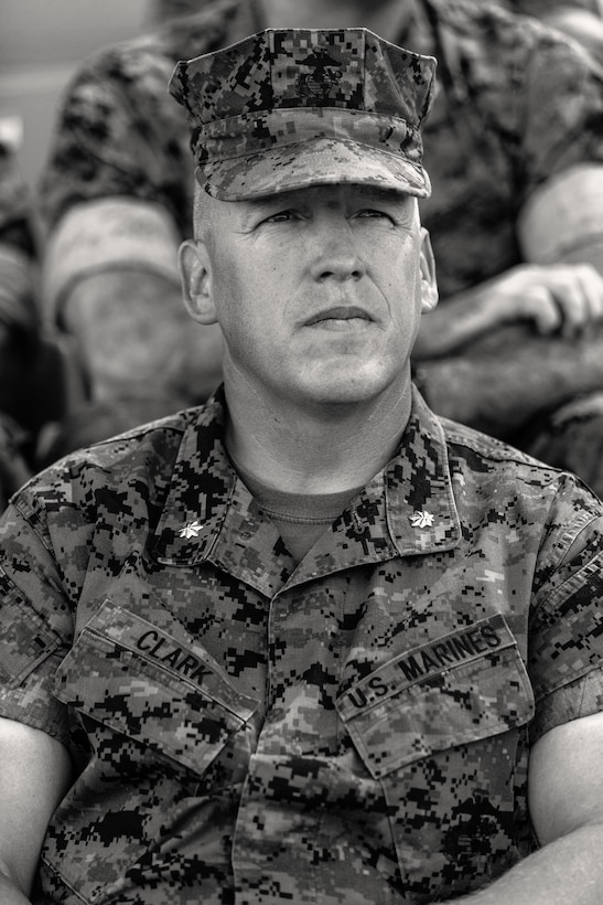 Lt. Col. Erick T. Clark, off-going commanding officer, 1st Battalion, 7th Marine Regiment, sits at the change of command ceremony for 1/7 aboard the Marine Corps Air Ground Combat Center, Twentynine Palms, Calif., June 4, 2018. 7th Marines where he relinquishes his command aboard the Marine Corps Air Ground Combat Center, Twentynine Palms, Calif., June 4, 2018. The change of command ceremony ensures that the unit and its Marines are never without official leadership, and also signifies an allegiance of Marines to their unit's commander. (U.S. Marine Corps photo by Lance Cpl. Rachel K. Porter)