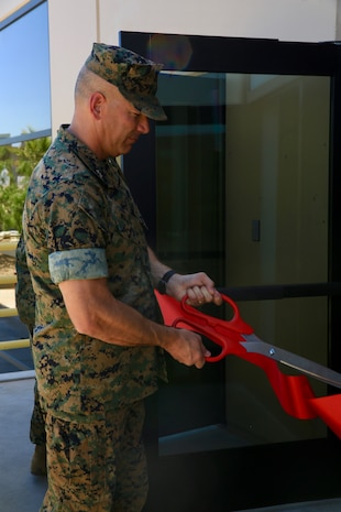 Combat Center Commanding General, Maj. Gen. William F. Mullen III, cuts the ribbon for the grand opening of the Wilburn Gym aboard the Marine Corps Air Ground Combat Center, Twentynine Palms, Calif., June 6, 2018. The gym was dedicated to retired Sgt. Maj. Ray V. Wilburn, a three-war veteran who left his mark on the installation and the local community. (U.S. Marine Corps photo by Lance Cpl. Dave Flores)