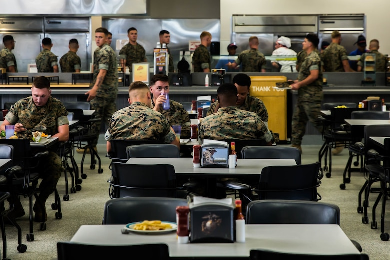 Marines enjoy their meal during the Phelps Mess Hall grand re-opening aboard the Marine Corps Air Ground Combat Center, Twentynine Palms, Calif., June 4, 2018. Phelps Hall has been closed since November 11, 2017, due to renovations to improve the efficiency of the facility. (U.S. Marine Corps photo by Lance Cpl. Margaret Gale)