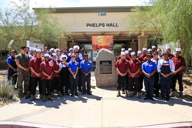 Food service Marines and Sedexo employees await the grand re-opening of Phelps Mess Hall aboard the Marine Corps Air Ground Combat Center, Twentynine Palms, Calif., June 4, 2018. Phelps Hall has been closed since November 11, 2017, due to renovations to improve the efficiency of the facility. (U.S. Marine Corps photo by Lance Cpl. Margaret Gale)