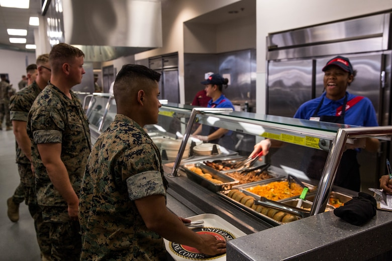 Marines are served lunch during the grand re-opening of Phelps Mess Hall aboard the Marine Corps Air Ground Combat Center, Twentynine Palms, Calif., June 4, 2018. Phelps Hall has been closed since November 11, 2017, due to renovations to improve the efficiency of the facility. (U.S. Marine Corps photo by Lance Cpl. Margaret Gale)