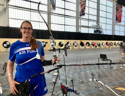 U.S. Air Force retired Lt. Col. Melissa McAvoy strikes a pose with her bow before archery finals at the U.S. Air Force Base Academy in Colorado Springs, Colorado, June 7, 2018. McAvoy was first introduced to the Air Force Wounded Warrior (AFW2) program in 2017, after suffering from complex post-traumatic stress disorder which stemmed from a sexual assault early in her career and was exasperated by the threat of landmines, harassment and multiple assaults incurred while being the only woman (and most of the time the only American) forward deployed in Ethiopia. (U.S. Air Force photo by Alexx Pons)