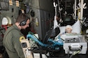 Maj. Philip Goebel, a Critical Care Air Transport Team physician with the 109th Airlift Wing, New York Air National Guard, prepare their patient for transfer to a guerney during the CCATT training event at the Minneapolis-St. Paul Air Reserve Station, Minn., May 31, 2018. (U.S. Air Force photo by Master Sgt. Eric Amidon)