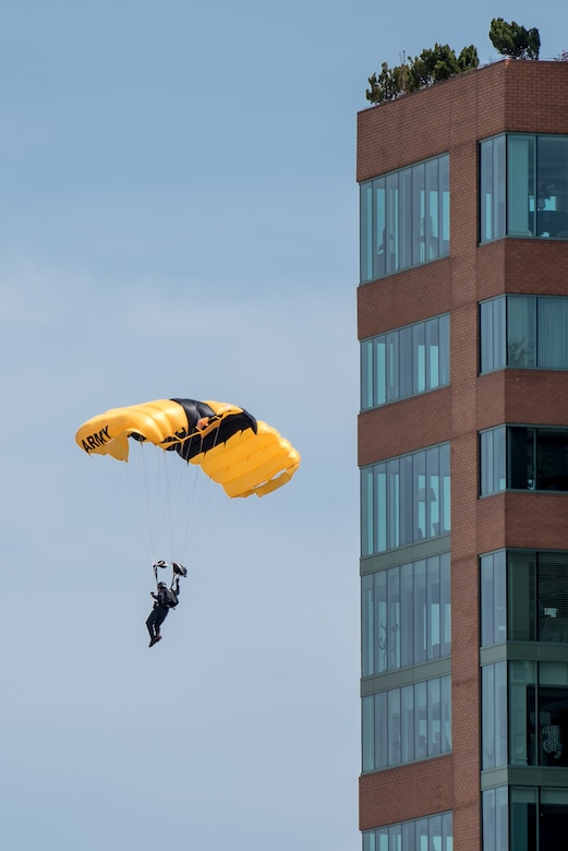 A Soldier from the U.S. Army's Golden Knights parachute demonstration team floats toward Waterfront Park in downtown Louisville, Ky., April 21, 2018, to kick off the Thunder Over Louisville air show. This year's show drew a crowd of more than 500,000 to the banks of the Ohio River. (U.S. Air National Guard photo by Lt. Col. Dale Greer)