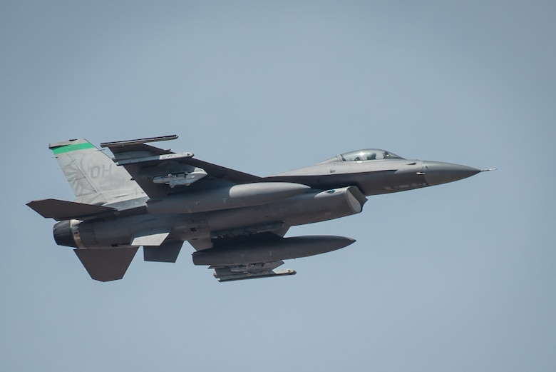 An F-16 Fighting Falcon from the Ohio Air National Guard's 180th Fighter Wing performs an aerial demonstration over the Ohio River April 21, 2018, during the Thunder Over Louisville air show in Louisville, Ky. The Kentucky Air National Guard once again served as the base of operations for military aircraft participating in the show, providing essential maintenance and logistical support. (U.S. Air National Guard photo by Lt. Col. Dale Greer)