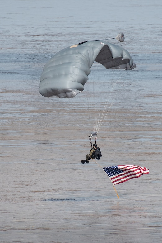 A special operator from the Kentucky Air National Guard's 123rd Special Tactics Squadron parachutes into the Ohio River from a C-130 aircraft during the Thunder Over Louisville air show in Louisville, Ky., April 21, 2018. The squadron is comprised of combat controllers, pararescuemen, special operations weathermen and special tactics officers. (U.S. Air National Guard photo by Lt. Col. Dale Greer)