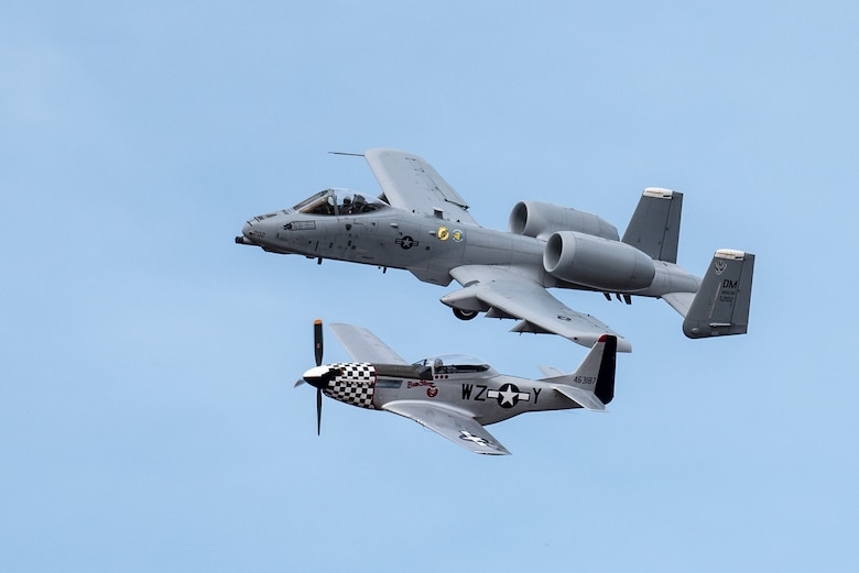 A U.S. Air Force A-10 Thunderbolt II aircraft participates in a heritage flight with a P-51 Mustang during the Thunder Over Louisville air show in Louisville, Ky., April 21, 2018. The Kentucky Air National Guard once again served as the base of operations for military aircraft participating in the show, providing essential maintenance and logistical support. (U.S. Air National Guard photo by Lt. Col. Dale Greer)