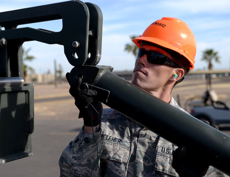 Senior Airman Corey Keleher, 56th Equipment Maintenance Squadron conventional weapons crew chief, assembles bomb-building equipment during a practice for the Air Force Combat Munitions competition June 6, 2018, at Luke Air Force Base, Ariz. The AFCO comp, taking place June 11-14, 2018, at Beale Air Force Base, Calif., will pit seven teams of ammo maintainers from bases around the world against each other in challenges that simulate the tasks required of them in combat operations. (U.S. Air Force photo by Senior Airman Ridge Shan)
