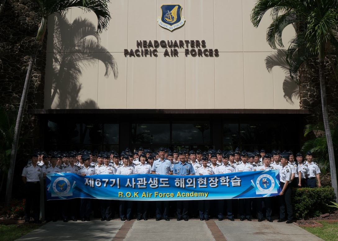 Republic of Korea Air Force (ROKAF) Brig. Gen Seung Bae Kong (center right), ROKAF Academy deputy superintendent and U.S. Air Force Brig. Gen Stephen Williams (right), Pacific Air Forces director of air and cyberspace operations, pose for group photo with ROKAF Academy senior cadets at Joint Base Pearl Harbor-Hickam, Hawaii, June 5, 2018. The visit is an opportunity for the cadets to see how PACAF operates and gain a better understanding of the Indo-Pacific region and the importance of the U.S.-ROK alliance. (U.S. Air Force photo by Staff Sgt. Daniel Robles)