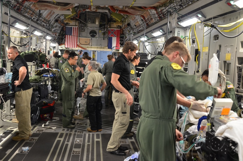 A joint medical team from the Mississippi Air National Guard's 183rd Air Evacuation Squadron and Joint Base San Antonio, Texas, helps members of the Guatemalan government load critically injured patients on a Mississippi ANG's 172nd Airlift Wing C-17 Globemaster III in Guatemala, June 6, 2018. The humanitarian aeromedical evacuation mission followed the recent eruption of Fuego Volcano. (U.S. Air National Guard photo by Tech. Sgt. Edward Staton)