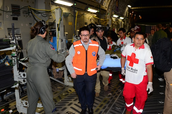 A joint medical team from the Mississippi Air National Guard's 183rd Air Evacuation Squadron and Joint Base San Antonio, Texas, assists members of the Guatemalan government with loading critically injured patients on a Mississippi ANG's 172nd Airlift Wing C-17 Globemaster III in Guatemala, June 6, 2018. The humanitarian aeromedical evacuation mission followed the recent eruption of Fuego Volcano. (U.S. Air National Guard photo by Tech. Sgt. Edward Staton)