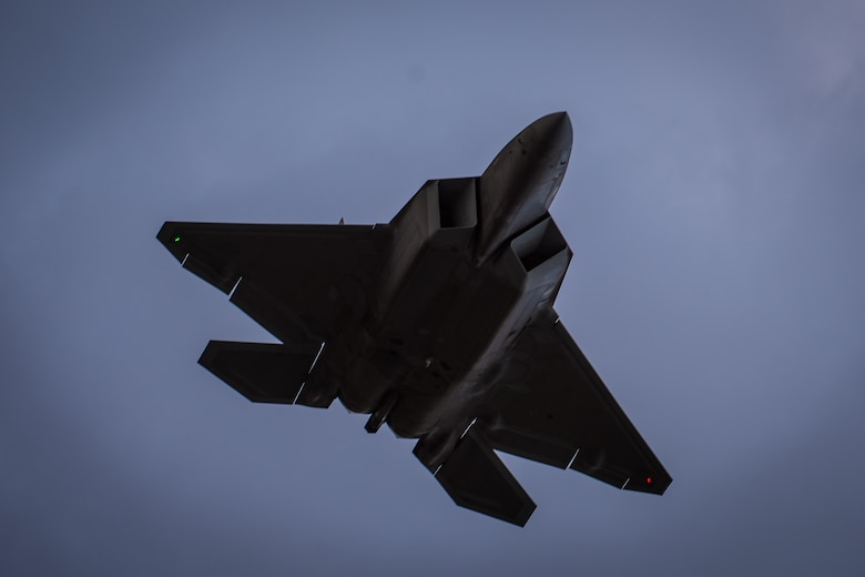 An F-22 Raptor soars through the sky above Joint Base Elmendorf-Richardson, Alaska, May 10, 2018. The Air Force announced the temporary relocation of personnel and F-22s from the 95th Fighter Squadron, Tyndall Air Force Base, Florida, to Joint Base (JB) Pearl Harbor-Hickam, Hawaii, and JB Elmendorf-Richardson, Alaska, Nov. 2, 2018. The unit is being relocated as Tyndall begins its long-term recovery following the devastation caused by Hurricane Michael, which struck the base in early October 2018..