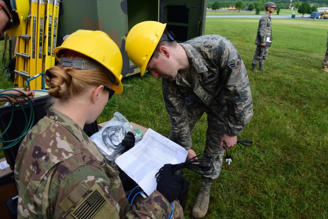 Airmen with the 211th Engineering Installation Squadron, Fort Indiantown Gap, Pennsylvania, check their inventory at the start of the squadron competition June 8, 2018. Checking inventory and starting the generators were the first steps each team took at the beginning of the competition. (U.S. Air National Guard photo by Senior Airman Julia Sorber/Released)