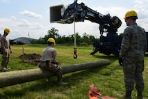 Airmen with the 211th Engineering Installation Squadron, Fort Indiantown Gap, Pennsylvania, prepare a telephone pole to be lifted during the squadron competition June 8, 2018. Each telephone pole was 40 feet high and weighed approximately 7,000 pounds. (U.S. Air National Guard photo by Senior Airman Julia Sorber/Released)