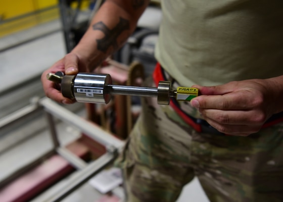 SSgt Hermann Nunez, 386th Expeditionary Aircraft Maintenance Squadron maintainer, holds the revised version of the 'Spline Insert Extractor,' which he helped create. (U.S. Air Force photo by Staff Sgt. Christopher Stoltz)
