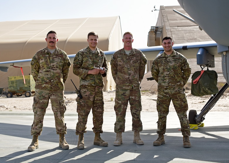 Staff Sgt. Hermann Nunez, 386th Expeditionary Aircraft Maintenance Squadron, Senior Airman Alex Young, 386th Expeditionary Maintenance Squadron, Tech. Sgt. Chance Cole, 386th EAMXS and Senior Airman Elio Esqueda, 386th EMXS, recently teamed up to create the 'Spline Insert Extractor.' (U.S. Air Force photo by Staff Sgt. Christopher Stoltz)